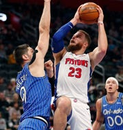 Pistons forward Blake Griffin shoots over Magic center Nikola Vucevic during the first half on Thursday, March 28, 2019, at Little Caesars Arena.