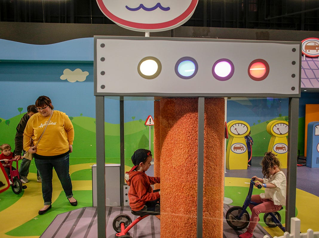 Children ride bikes through a car wash in Danny Dog's Garage play area at Peppa Pig World of Play attraction at Great Lakes Crossing in Auburn Hills, Mich. photographed on Friday, March 29, 2019.