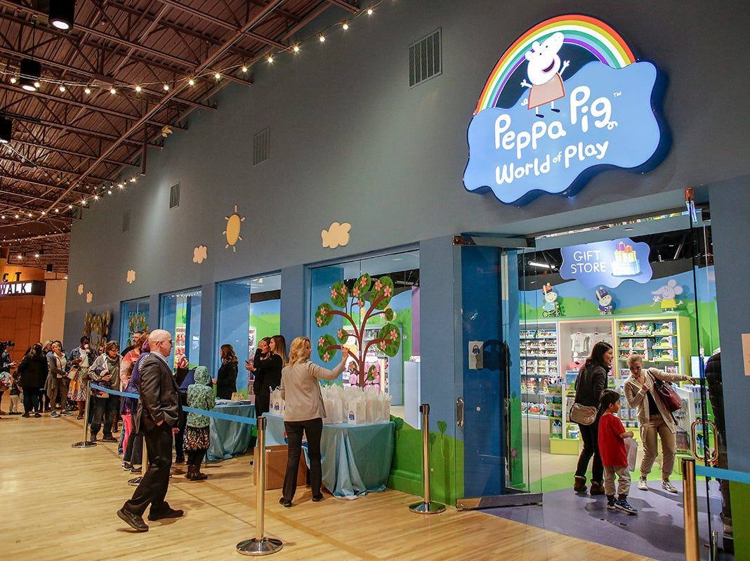 People stand in line to receive gift bags at the media preview of Peppa Pig World of Play attraction at Great Lakes Crossing in Auburn Hills, Mich. photographed on Friday, March 29, 2019.