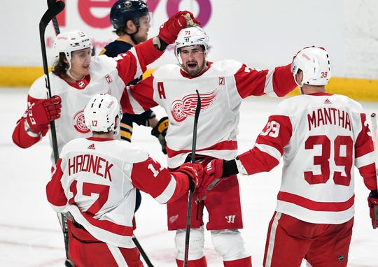 Red Wings center Dylan Larkin, center, celebrates his second goal of the night with left wing Tyler Bertuzzi, left, defenseman Filip Hronek and right wing Anthony Mantha during the third period of the Wings' 5-4 win on Thursday, March 28, 2019, in Buffalo, N.Y.