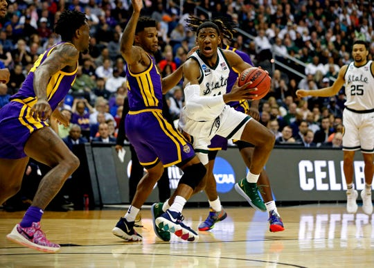 Michigan State forward Aaron Henry drives to the basket against LSU guard Marlon Taylor during the first half of an East Region semifinal in the NCAA tournament on Friday, March 29, 2019, in Washington.