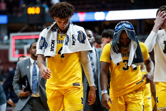 Michigan forward Isaiah Livers (4)  and guard Zavier Simpson (3) walk off the court after the Wolverines lost 63-44 to Texas Tech at the Sweet 16 game at Honda Center in Anaheim, Calif., Thursday, March 28, 2019.