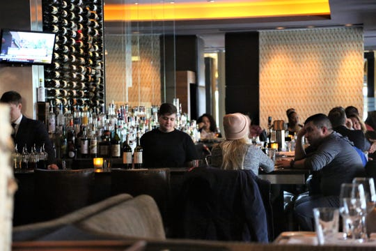 Ten years into its run, weekday happy hour is still a popular draw at Michael Symon's Roast in Detroit.