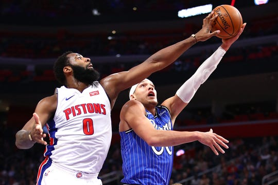 Magic forward Aaron Gordon has his shot blocked by Pistons center Andre Drummond during the first half on March 28, at Little Caesars Arena.