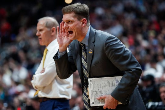 Michigan assistant coach Luke Yaklich talks to players during the second half of the 63-44 loss in the Sweet 16 against Texas Tech in Anaheim, Calif., Thursday, March 28, 2019.