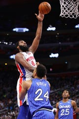 Andre Drummond takes a shot over the Magic's Khem Birch on Thursday.