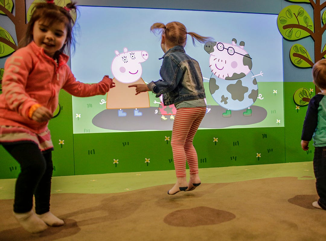 Children jump up and down on a pad that makes squishy noises simulating mud puddles in the muddy puddles play area at Peppa Pig World of Play attraction at Great Lakes Crossing in Auburn Hills, Mich. photographed on Friday, March 29, 2019.