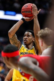 Michigan guard Charles Matthews (1) attempts for a free throw against Texas Tech during the second half of the 63-44 loss in the Sweet 16 against Texas Tech in Anaheim, Calif., Thursday, March 28, 2019.