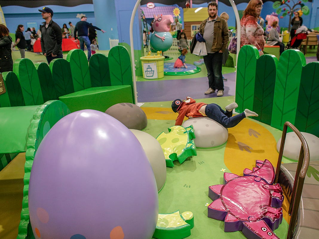 Kids bounce around in George's Dinosaur Discovery at Peppa Pig World of Play attraction at Great Lakes Crossing in Auburn Hills, Mich. photographed on Friday, March 29, 2019.