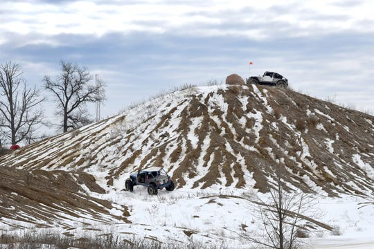 Off-road enthusiasts try their luck at scaling a mini-mountain at the Frozen Mines Run, Feb. 23, 2019, at a future Oakland County park for ORV buffs.