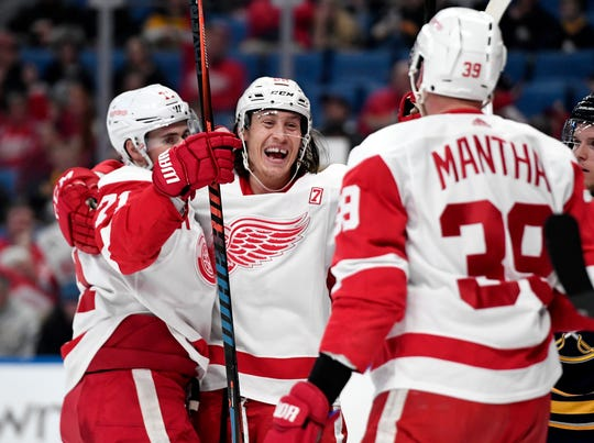 Red Wings left wing Tyler Bertuzzi, center, celebrates his goal with center Dylan Larkin, left, and right wing Anthony Mantha during the first period against the Buffalo Sabres in Buffalo, N.Y., Thursday, March 28, 2019.
