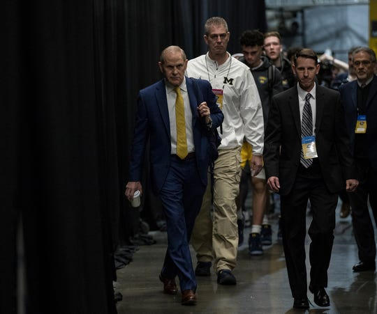 Michigan coach John Beilein and the basketball team arrive at the Honda Center before the Sweet 16 game against Texas Tech in Anaheim, Calif., Thursday, March 28, 2019.