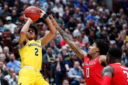 Michigan guard Jordan Poole (2) makes a jump shot against Texas Tech guard Kyler Edwards (0) during the first half of the Sweet 16 game at Honda Center in Anaheim, Calif., Thursday, March 28, 2019.