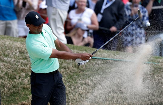 Tiger Woods plays a shot from a bunker on the sixth hole during round-robin play Thursday at the Dell Match Play Championship golf tournament.
