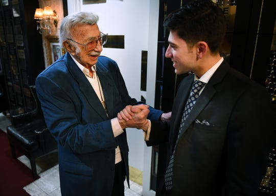 Jewish News restaurant columnist Danny Raskin, 100, jokes around with Ari Zarkin, son of Mark Zarkin, the owner of Steven Lelli's Inn on the Green restaurant in Farmington Hills.