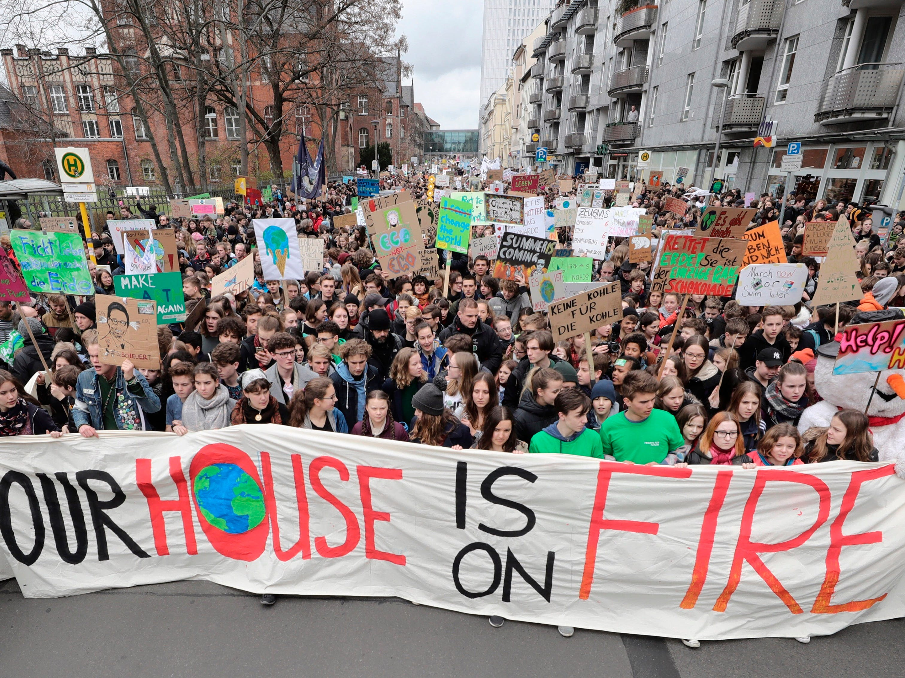 Swedish climate activist Greta Thunberg, center in first row behind the banner, attends the 'Friday For Future' rally in Berlin, Germany, Friday, March 29, 2019. Thousands of students are gathering in the German capital, skipping school to take part in a rally demanding action against climate change.