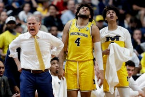 Michigan coach John Beilein yells during the first half.