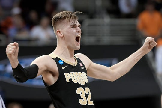 Purdue center Matt Haarms celebrates during overtime of an NCAA Tournament regional semifinal game against Tennessee Thursday. Purdue won 99-94.
