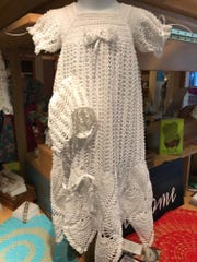 A crocheted christening gown set from Ramos de Soto.