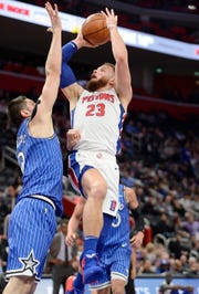 Pistons' Blake Griffin scores over Magic's Nikola Vucevic in the second quarter Thursday. Griffin finished with 20 points and 10 rebounds in Detroit's 115-98 victory.