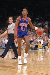 The Pistons' Isiah Thomas plays against the Lakers during the 1989-90 season.