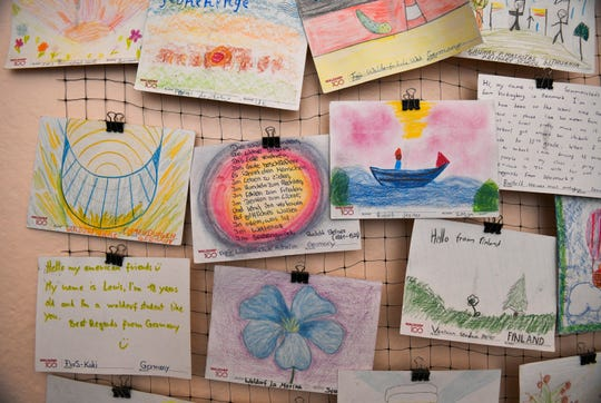 These hand-drawn postcards on display at the Detroit Waldorf School were sent from students at Waldorf schools in Europe and Africa.