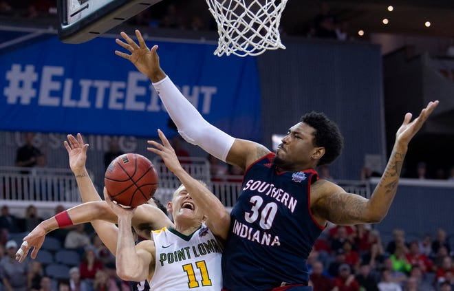 Point Loma's Tanner Nelson (11) is defended by University of Southern Indiana's Josh Price (30) during last year's semifinal matchup at the NCAA Men's Division II Elite 8 Basketball Tournament. Price's career-high 25 points helped USI defeat Ohio Valley 91-68 on Tuesday night.