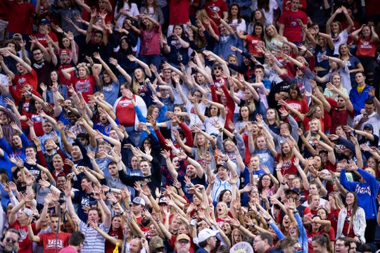 University of Southern Indiana Screaming Eagles fans try to distract a Point Loma Sea Lions free throw shooter during their semifinal matchup at the NCAA Men's Division II Elite 8 Basketball Tournament at the Ford Center in Evansville Thursday night.