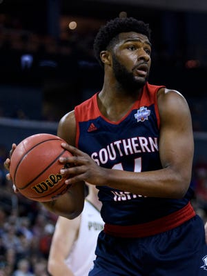 University of Southern Indiana's Emmanuel Little (14) looks to make a pass during the NCAA Division II Final Four against the Point Loma Sea Lions at Ford Center in Evansville, Ind., Thursday, March 28, 2019. The Screaming Eagles fell to the Sea Lions, 81-71.