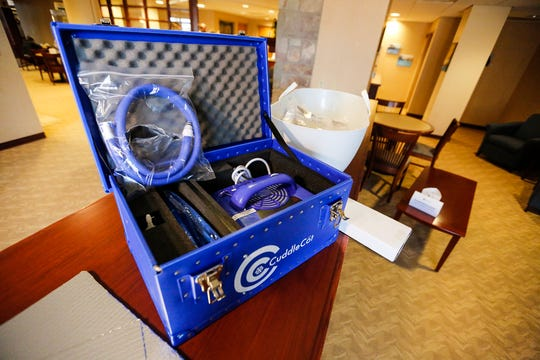 A cooling unit and water hoses sit in a case next to a CuddleCot March 29, 2019 at St. Agnes Hospital in Fond du Lac. A CuddleCot is a water-cooled bassinet designed to prolong the length of time family can spend with a baby that was born deceased. The Cuddle Cot was donated to the hospital by Tabitha and Salvatore Lazaro III.