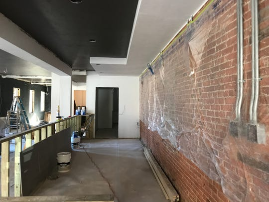 The bar area in The Livery Lofts tavern will feature brick wall with four flat screen TVs, as well as old-German style murals.