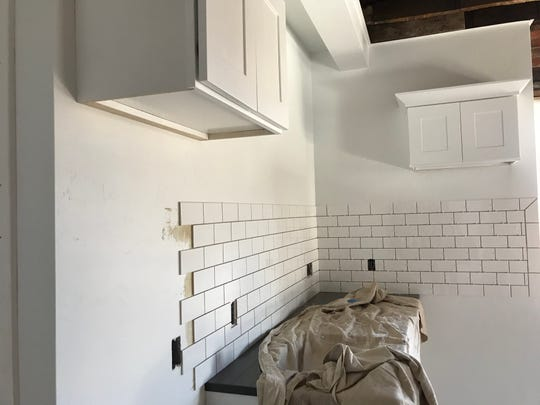 The kitchen in the lofts will have a subway tile back-splash and white cabinets.