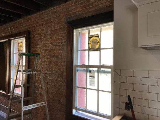 The lofts will have exposed brick walls and windows framed with reclaimed baseboards.