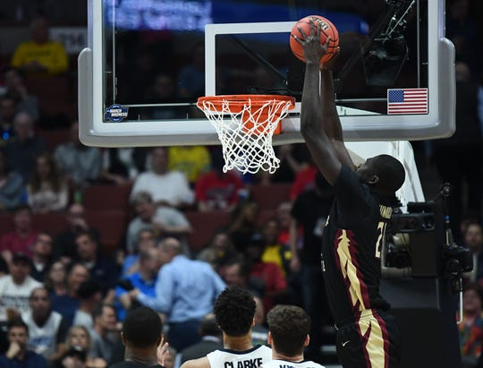 Florida State senior center Christ Koumadje (21) dunks to score a a basket against Gonzaga during the semifinals of the West Regional of the 2019 NCAA Tournament at the Honda Center.