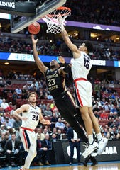 Florida State guard M.J. Walker (23) moves to the basket against Gonzaga forward Brandon Clarke (15) during the semifinals of the West Regional of the 2019 NCAA Tournament at Honda Center.