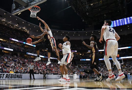 Florida State guard PJ Savoy (5) moves to the basket against Gonzaga forward Rui Hachimura (21) during the semifinals of the West Regional of the 2019 NCAA Tournament at the Honda Center.