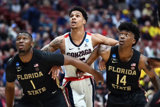 Gonzaga forward Brandon Clarke (15) moves in against Florida State forward Raiquan Gray (1) and guard Terance Mann (14) during the semifinals of the West Regional of the 2019 NCAA Tournament at the Honda Center.