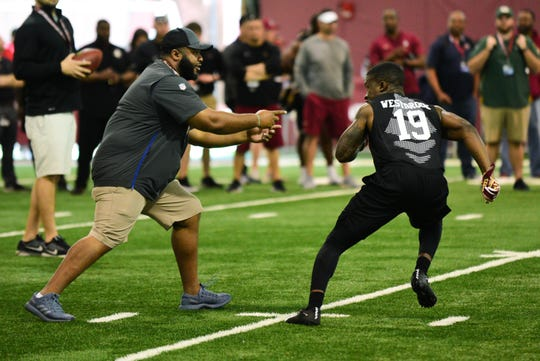 NFL Scouts run a passing drill with defensive back A.J. Westbrook during FSU's Pro Day.