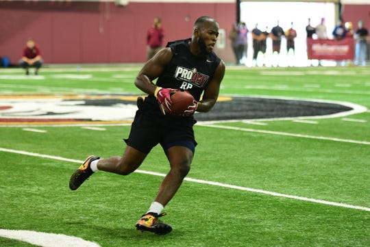 Running back Jacques Patrick runs drills during FSU's Pro Day.