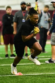 Wide reciever Nyquan Murray runs drills as part of FSU's Pro Day.
