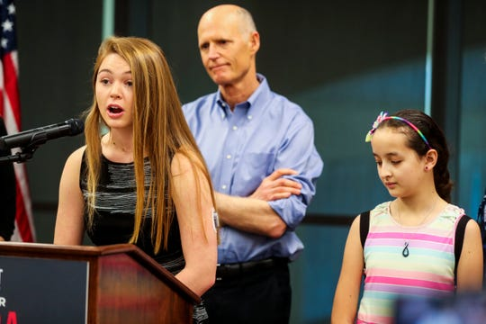Emmabella Rudd, 17 of Sarasota spoke to the crowd at the press conference. Sabine Rivera, 12 of Naples, and Senator Rick Scott look on. Senator Rick Scott stopped in Fort Myers to make an announcement regarding efforts to make healthcare more affordable and accessible for Florida families. The press conference was held at the Southwest Florida International Airport Wright Brothers Conference Room, Fort Myers, FL. A few Florida children with Type 1 diabetes, Sabine Rivera, 12 of Naples, Emmabella Rudd, 17 of Sarasota, and Lucas Lye, 14 of Naples, were on hand to tell their stories about how their families deal with the cost of insulin.