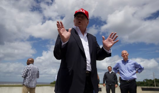 President Trump addresses members of the media during a visit to Lake Okeechobee on March 29.