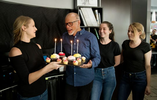 Joelle Findley, left, Katie Chamberlain, and Jessica Connolly, of Cru restaurant at Bell Tower Shops in south Fort Myers, wish co-worker Cesar Otero a happy birthday recently. Cru is closing permanently in late April.