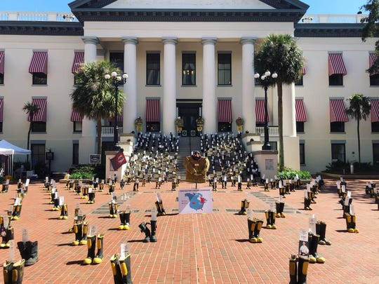 Boots representing firefighters who have died or are fighting cancer made a statement at the start of this year's session in Tallahassee