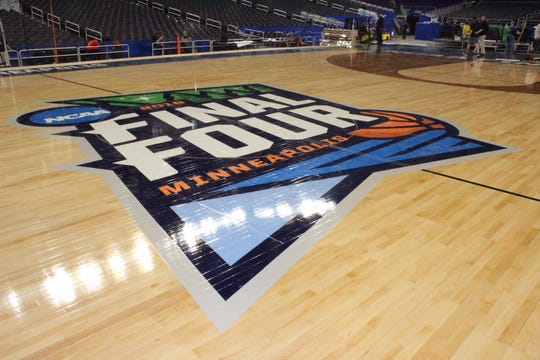 The NCAA Final Four logo on the basketball court built by Connor Sports for the tournament in Minneapolis. The court is made with maple grown and harvested by the Menoninee Tribal Industries in Keshena.