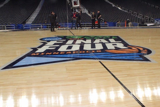 The Final Four logo on the basketball court built for the tournament in Minneapolis by Connor Sports, The court is made of maple grown and harvested by Menoninee Tribal Enterprises in Keshena.