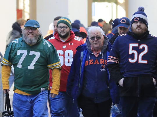 Russell Beckman (left) arrives at Soldier Field for the Green Bay Packers game against the Chicago Bears on Dec. 16, 2018 in Chicago.