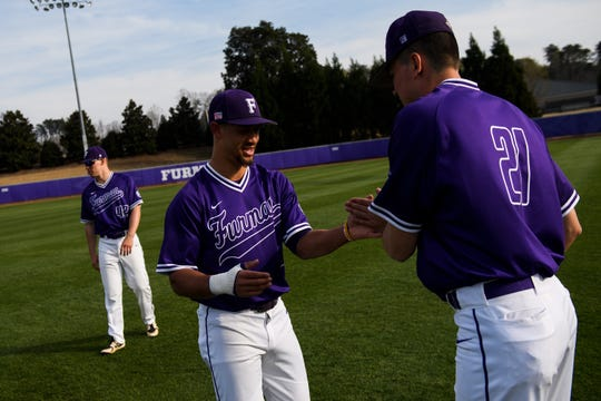 Furman's Jabari Richards (6) and Nik Verbeke (21) greet each other before their game against The Citadel at Latham Baseball Stadium Friday, March 29, 2019.