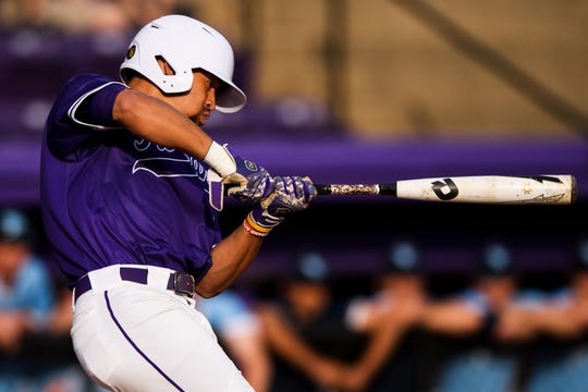 Furman's Jabari Richards (6) attempts to hit the ball during their game against The Citadel at Latham Baseball Stadium Friday, March 29, 2019.