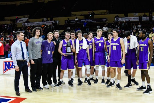 The Carroll College Saints pose with their NAIA national runner-up trophy last week in Kansas City, Mo.